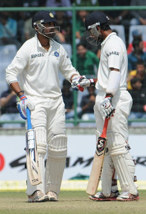 Cheteshwar Pujara and Murali Vijay of India during their 108-run opening stand partnership during the 4th test match of Border-Gavaskar Trophy at Feroz Shah Kotla Stadium in Delhi on March 23, 2013. P