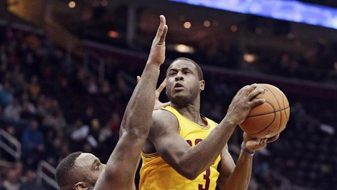 Cleveland Cavaliers' Dion Waiters, right, jumps to the basket against Orlando Magic's Glen Davis during the second quarter of an NBA basketball game Thursday, Jan. 2, 2014, in Cleveland