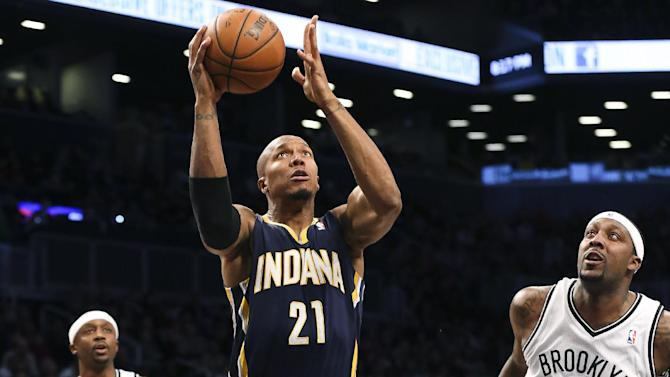 Indiana Pacers power forward David West (21) shoots the ball as Brooklyn Nets center Andray Blatche (0) and shooting guard Jason Terry (31) look on during the first quarter of an NBA basketball game, Saturday, Nov. 9, 2013, at the Barclays Center in New York