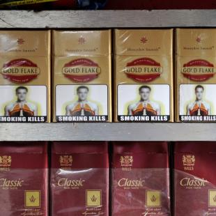 Packets of cigarettes with an image said to have a likeness to England and Chelsea soccer player John Terry stand on display at a roadside shop in New Delhi, India, Tuesday, Jan. 3, 2012. Terry's managers from England and Chelsea teams are set to take legal action against the use of the image, according to news reports. The slightly blurred image has appeared as part of anti-smoking pictorial warnings created by the Directorate of Visual Publicity for use on cigarette packets in the country. (AP Photo/Tsering Topgyal)