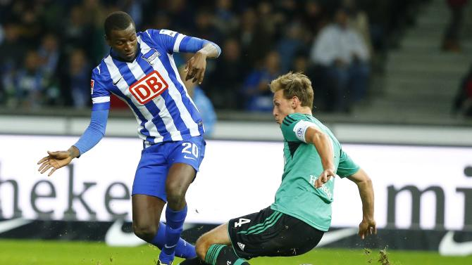 Hertha Berlin's Ramos and Schalke 04's Hoewedes fight for ball during German first division Bundesliga soccer match in Berlin