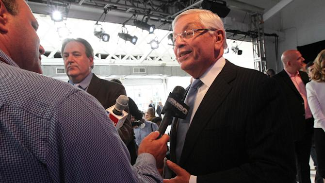 NBA commissioner David Stern, foreground right, speaks to the media following a press conference Wednesday Sept. 25, 2013, in New York, announcing the selection of the city to host the NBA All-Star game in 2015. The 64th NBA All-Star game is scheduled to be played at New York's Madison Square Garden Sunday Feb. 15, 2015 with Friday and Saturday night events being held at the Barclays Center in the Brooklyn borough of New York