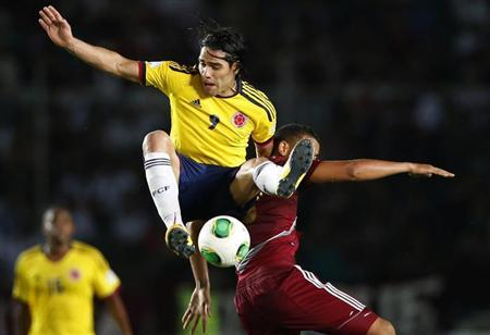 Colombia's Radamel challenges Venezuela's Tomas Rincon during their 2014 World Cup qualifying soccer match in Puerto Ordaz