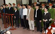 Pham Thanh Binh (3rd L, front line), the former chairman and other top executives of Vinashin, a Vietnamese shipbuilder group whose huge debts shook investor confidence in the communist nation, stand trial in the northern coastal city of Haiphong, on March 27