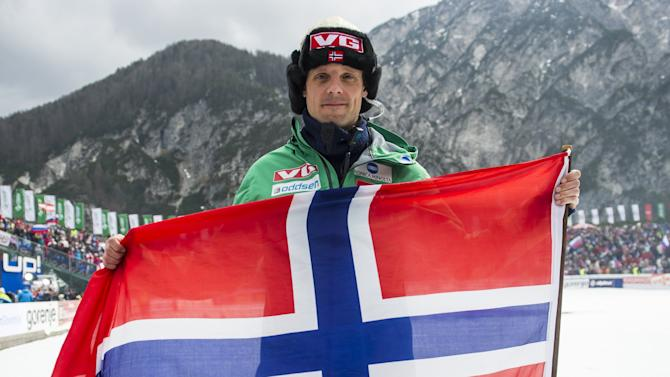 Alexander Stoeckl, head coach of Norwegian Skijumping Team waves with a Norwegian flag after final round of FIS Ski Flying World Cup 2011-2012 in Planica on March 18, 2012. AFP PHOTO / Jure Makovec (Photo credit should read Jure Makovec/AFP/Getty Images)