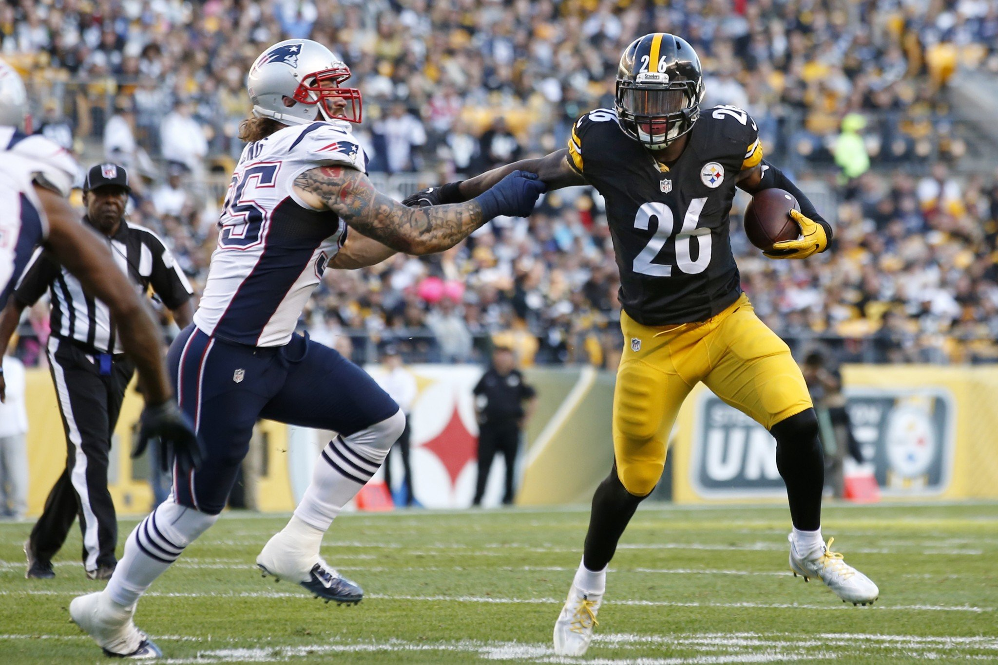 Keeping Le'Veon Bell in check will be job No. 1 for the New England defense. (AP)