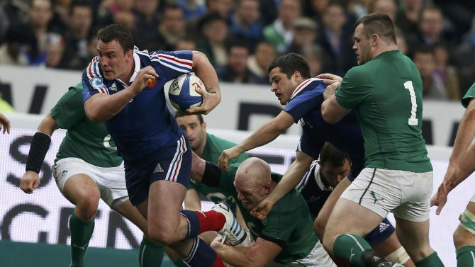 France's Picamoles and France's Dulin are surrounded by Ireland's players during their Six Nations rugby union match at the Stade de France in Saint-Denis, near Paris