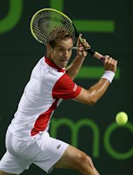Richard Gasquet of France plays a backhand against Tomas Berdych of Czech Republic during their quarter-final match at the Sony Open at Crandon Park Tennis Center in Key Biscayne, Florida, on March 28, 2013. Gasquet won 6-3, 6-3