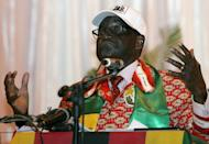 Zimbabwe's President and leader of ruling ZANU-PF party Robert Mugabe in Gweru, on December 8, 2012. Mugabe criticises Nelson Mandela for being too soft on whites, in a documentary giving a rare and intimate look into the family life of one of Africa's longest serving and most vilified leaders