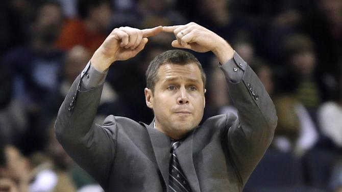 Memphis Grizzlies coach David Joerger signals to players during the second half of an NBA basketball game against the Denver Nuggets in Memphis, Tenn., Saturday, Dec. 28, 2013. The Grizzlies defeated the Nuggets 120-99