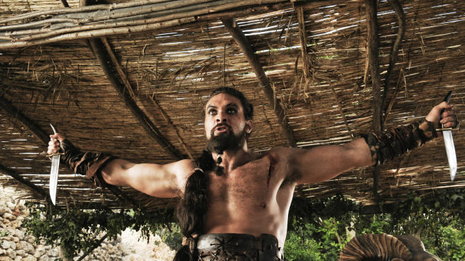 "In this publicity image released by HBO, Jason Momoa portrays Khal Drogo in a scene from the HBO series, ""Game of Thrones."" The 63rd Emmy Award nomination announcements will be made on Thursday, July 14, 2011. (AP Photo/HBO, Helen Sloan)"