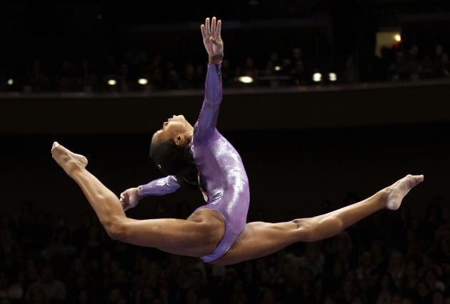 American gymnast Gabrielle Douglas  performs as an alternate on the balance beam during the American Cup gymnastics meet at Madison Square Garden in New York, Saturday, March 3, 2012. (AP Photo/Kathy