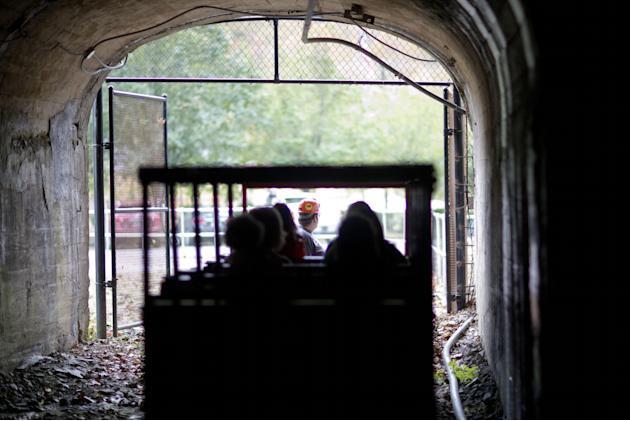 In this Oct. 18, 2014 photo, a worker drives a rail car while conducting a tour of the Portal 31 coal mine that has been turned into a tourist attraction in Lynch, Ky. Many areas in Central Appalachia