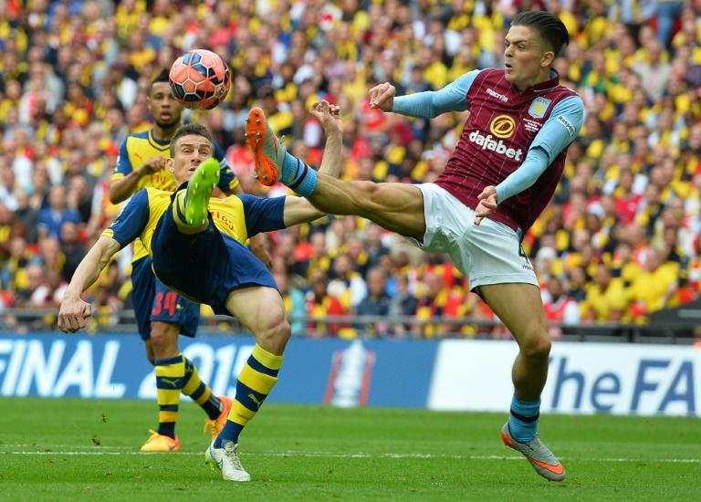 Aston Villa midfielder Jack Grealish (right) in action in the FA Cup final against Arsenal on May 30, 2015