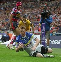 Chris Riley scores a try for Warrington in the Challenge Cup final