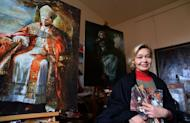 Natalia Tsarkova next to a painting of Pope Benedict XVI on December 18, 2012 in her studio. Tsarkova, the Vatican's latest official painter. arrived in Rome in the early 1990s and began doing portraits of Roman aristocrats, who introduced her at the Vatican, where her background captured the attention of late pope John Paul II