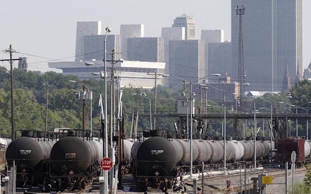 FILE - In this July 16, 2013, file photo, railroad oil tankers are lined up at the Port of Albany, in Albany, N.Y. New York regulators are stepping up air monitoring at the Port of Albany and enhancin