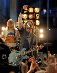 "FILE- Dave Grohl and the Foo Fighters performs during the 54th annual Grammy Awards in this file photo dated Sunday, Feb. 12, 2012, in Los Angeles. On Tuesday Aug. 28, 2012, music industry online magazine NME says the Foo Fighters have played their ""last show for a long time,"" but an official familiar with the group says more concerts are scheduled, as speculation was ignited by Grohl's closing comments at the end of Sunday's Reading Festival in England.(AP Photo/Chris Pizzello, File)"