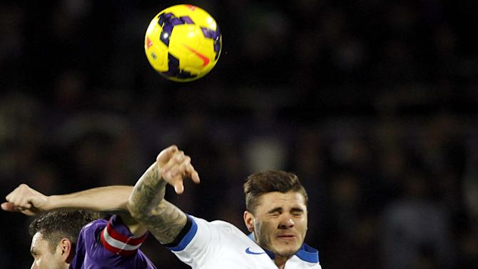 Fiorentina's Gonzalo Rodriguez, left, and Inter Milan's Mauro Icardi vie for the ball during a Serie A soccer match between Fiorentina and Inter Milan, at the Artemio Franchi stadium in Florence, Italy, Saturday, Feb. 15, 2014