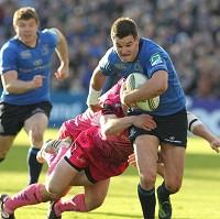 Match-winner Jonathan Sexton, right, is tackled during Leinster's victory over Exeter
