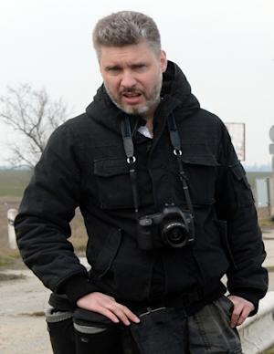 A picture taken on March 14, 2014 in the Crimean town of Dzhankoy, shows Andrei Stenin, a Russian photographer working for RIA Novosti
