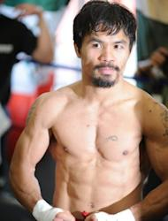 Manny Pacquiao poses at a media day workout at Wildcard Boxing Club in Hollywood, California, on October 26. Pacquiao will defend his World Boxing Organization (WBO) welterweight title against Juan Manuel Marquez in Las Vegas, on November 12