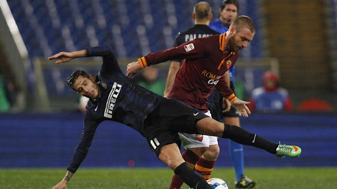 AS Roma midfielder Daniele De Rossi, right, fouls Inter Milan midfielder Gabriel Alvarez during an Italian Serie A soccer match between AS Roma and Inter Milan at Rome's Olympic stadium, Saturday, March 1, 2014