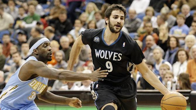 Minnesota Timberwolves' Ricky Rubio, right, of Spain, drives around Denver Nuggets's Ty Lawson in the first quarter of an NBA basketball game on Wednesday, Nov. 27, 2013, in Minneapolis