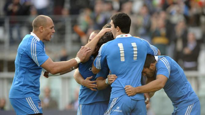 Italy's Luke McLean celebrates with team mates after scoring during their Six Nations rugby union match against Australia at the Olympic stadium in Turin