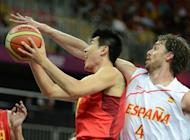 Chinese guard Wang Shipeng (L) is challenged by Spanish forward Pau Gasol during the Men's Preliminary Round Group B match Spain vs China at the London 2012 Olympic Games. Spain won 97-81