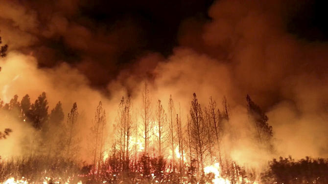 In this undated photo provided by the U.S. Forest Service, the Rim Fire burns near Yosemite National Park, Calif. The wildfire outside Yosemite National Park — one of more than 50 major brush blazes burning across the western U.S. — more than tripled in size overnight and still threatens about 2,500 homes, hotels and camp buildings. Fire officials said the blaze burning in remote, steep terrain had grown to more than 84 square miles and was only 2 percent contained on Thursday, down from 5 percent a day earlier. (AP Photo/U.S. Forest Service)