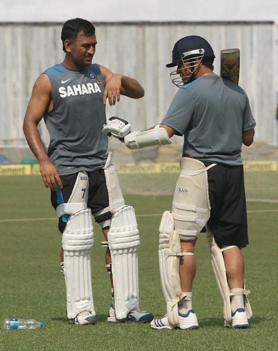 Indian Cricketers Sachin Tendulkar and Mahendra Singh Dhoni during a practice session ahead of test match between India and West Indies starting on Nov 6 at Eden Gardens in Kolkata on Nov.5, 2013. (Ph