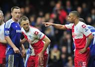 Chelsea defender John Terry (L) and Queens Park Rangers defender Anton Ferdinand during a match at Stamford Bridge in west London on April 29, 2012. Terry arrived in court on Monday for his trial on charges of racially abusing Ferdinand during a football match in 2011