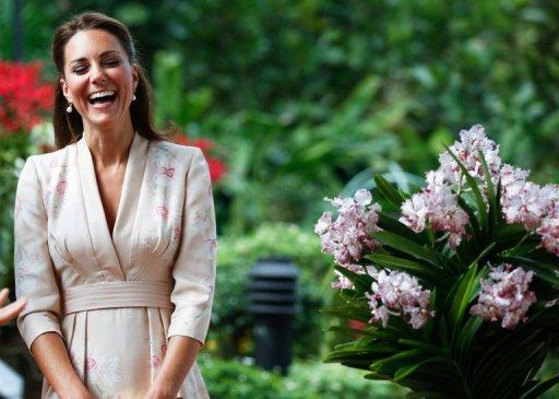 Catherine, the Duchess of Cambridge and wife of Britain's Prince William, smiles during a ceremony naming a hybrid orchid in their honour at the Singapore Botanical Gardens in Singapore on September 11. The couple were greeted by crowds of cheering well-wishers Tuesday as they arrived in Singapore at the start of an Asia-Pacific tour.