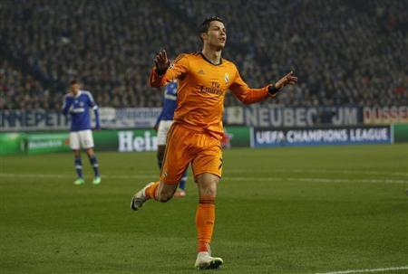 Real Madrid's Cristiano Ronaldo celebrates a goal against Schalke 04 during their Champions League soccer match in Gelsenkirchen