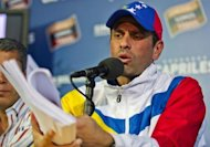 Venezuelan presidential election runner-up Henrique Capriles holds a press conference in Caracas, on April 16, 2013. Nicolas Maduro steamrolled toward inauguration as Venezuela's president Thursday despite days of flaring tensions over opposition demands for a recount in elections to replace Hugo Chavez.