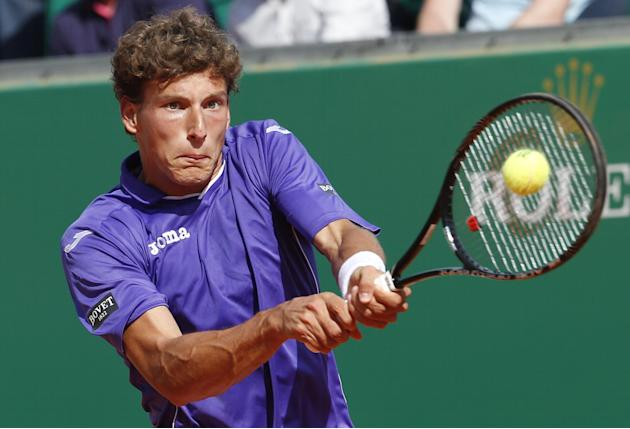 Pablo Carreno Busta of Spain returns the ball to Novak Djokovic of Serbia during their third round match of the Monte Carlo Tennis Masters tournament in Monaco, Thursday, April 17, 2014. Djokovic won