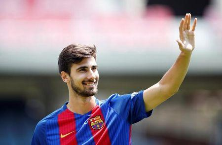 FC Barcelona's newly signed soccer player Andre Gomes waves to the crowd during his presentation at Miniestadi stadium in Barcelona