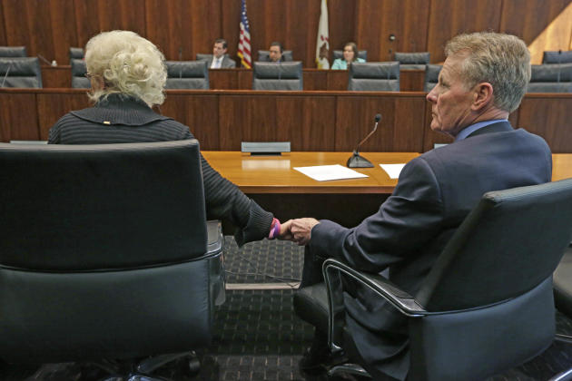 Illinois House Speaker Michael Madigan, right, and his wife Shirley Madigan, chairman of the Illinois Arts Council Agency hold hands as they appear before an Illinois House committee meeting Thursday,
