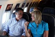 "Republican presidential candidate Mitt Romney (L) and his wife Ann Romney talk on the campaign plane on September 1. Romney has criticized setting a withdrawal date for US forces from Afghanistan, saying doing so would aid US enemies. But he has also suggested that the ""right timetable"" for a withdrawal is by the end of 2014 -- a date already set by NATO"