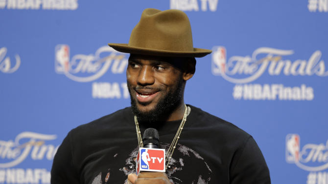 "FILE - In this June 10, 2015, file photo, Cleveland Cavaliers forward LeBron James (23) answers a question during a press conference following Game 3 of basketball's NBA Finals in Cleveland. LeBron James is bringing a little Hollywood to his Ohio hometown. The NBA superstar is hosting a private screening of ""Trainwreck,"" a new comedy in which he plays himself in a supporting role as the best friend of star Bill Hader. James is showing the film to family and friends in Akron on Friday, July 10, 2015, a few days before the movie's premiere in New York.  (AP Photo/Tony Dejak, File)"
