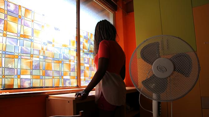 "Nigerian ex-prostitute ""Beauty"" (a pseudonym), poses in a social support centre for trafficked girls near Catania in Italy"