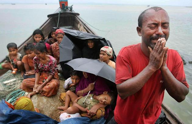 In this June 13, 2012, file photo, a Rohingya Muslim man who fled Myanmar to Bangladesh to escape religious violence, cries as he pleads from a boat after he and others were intercepted by Bangladeshi