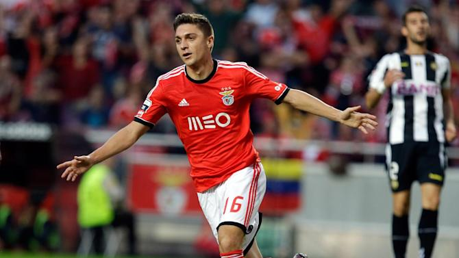 Benfica's Siqueira celebrates after scoring the opening goal during their Portuguese league soccer match against Nacional at Benfica's Luz stadium in Lisbon, Sunday, Oct. 27 2013,