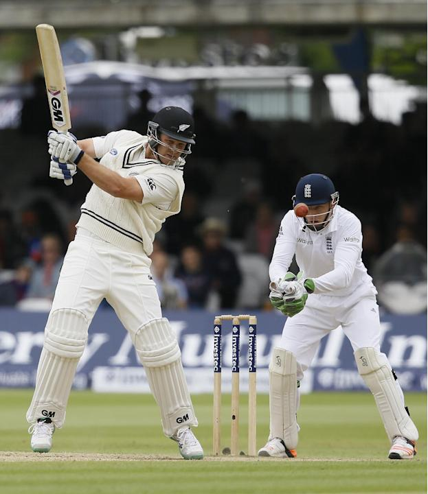 New Zealand's Corey Anderson plays a shot off the bowling of England's Moeen Ali during the fifth day of the first Test match between England and New Zealand at Lord's cricket ground in Lo