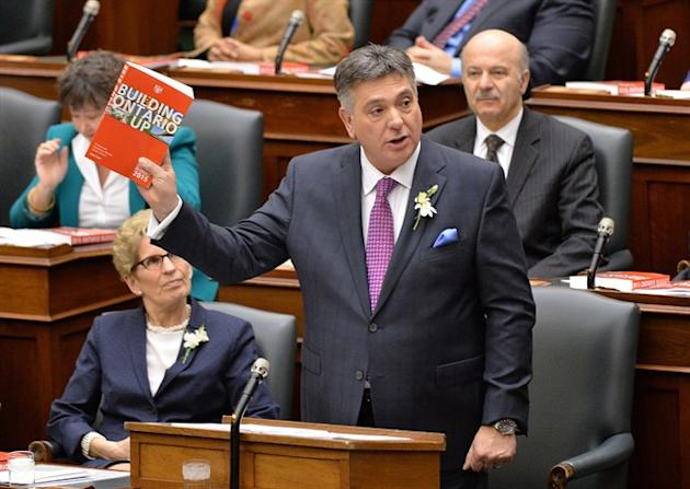 Ontario Finance Minister Charles Sousa delivers the provincial budget as Premier Kathleen Wynne looks on at Queen's Park in Toronto on Thursday, April 23, 2015. THE CANADIAN PRESS/Nathan Denette