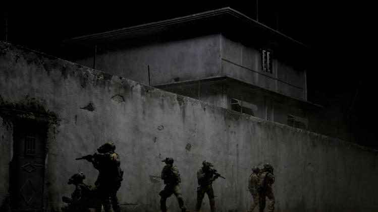 "This undated publicity film image provided by Columbia Pictures Industries, Inc. shows elite Navy SEALs raiding Osama Bin Laden's compound in the dark night in Columbia Pictures' gripping new thriller directed by Kathryn Bigelow, ""Zero Dark Thirty."" (AP Photo/Columbia Pictures Industries, Inc., Jonathan Olley)"
