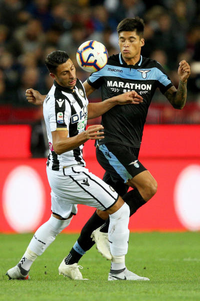 Udinese's Rolando Mandragora, left, and Lazio's Joaquin Correa vie for the ball during a Serie A soccer match between Udinese and Lazio at the Friuli stadium in Udine, Italy, Wednesday, Sept.26, 2018. (Stefano Lancia/ANSA via AP)