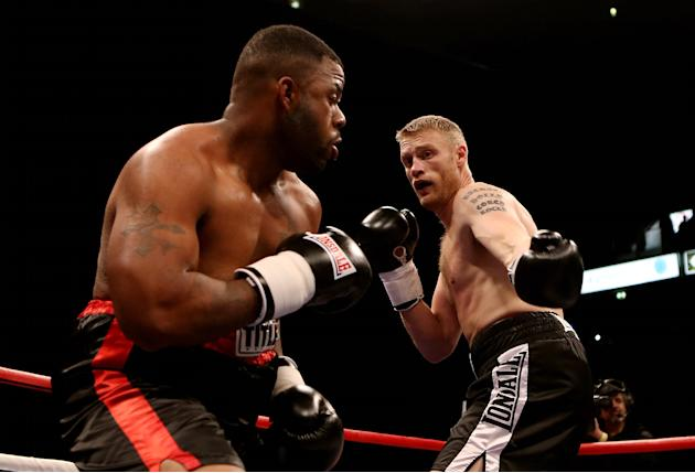 MANCHESTER, ENGLAND - NOVEMBER 30:  Andrew Flintoff in action with Richard Dawson during their International Heavyweight bout at MEN Arena on November 30, 2012 in Manchester, England.  (Photo by Scott