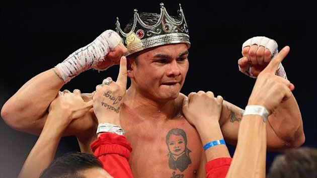 Marcos Maidana celebrates his unanimous decision against Adrien Broner becoming the new WBA Welterweight Title champion at Alamodome